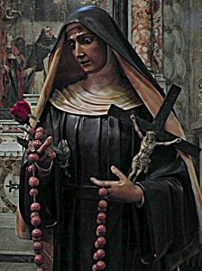 Statue of Mary holding a red rose