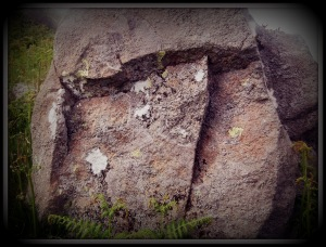 Large stone with chunks cut out