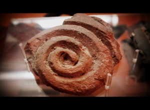 ancient pottery with the spiral symbol