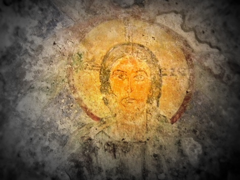 A painting of an enlightened man on the walls of 2nd Century Christian catacombs, Italy